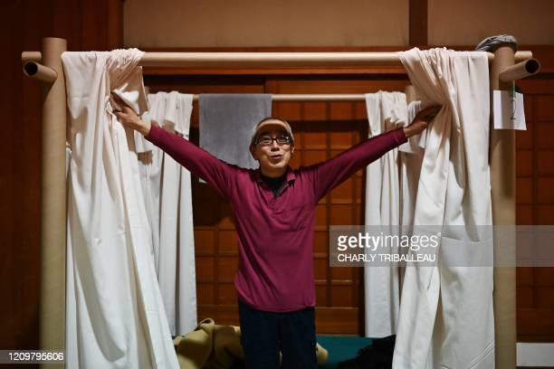 Katsuya Asao gestures at a shelter provided by Kanagawa prefecture for the people who cant afford to rent an apartment and used to stay at designated...