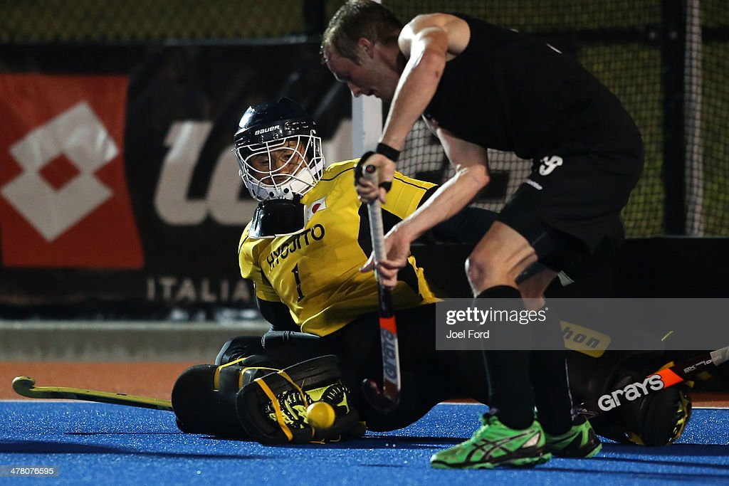 Katsuya Takase of Japan blocks a shot by Hugo Inglis of New Zealand during the Test Match between the New Zealand Black Sticks and Japan at Blake Park on March 12, 2014 in Mount Maunganui, New Zealand.