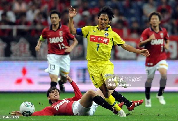 Katsuyuki Miyazawa of Montedio Yamagata controls the ball against Yosuke Kashiwagi of Urawa Red Diamonds during the J.League match between Urawa Red...