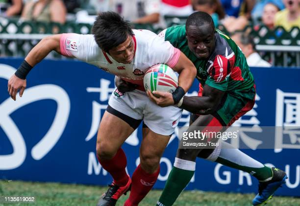 Katsuyuki Sakai of Japan is tackled in their match against Kenya at Challenge Trophy Semi Finals on day three of the Cathay Pacific/HSBC Hong Kong...