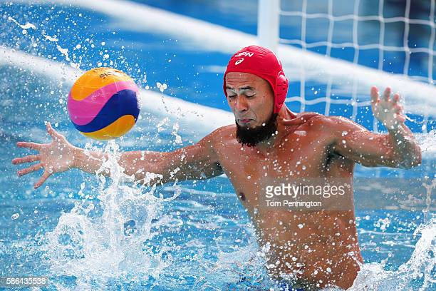 Katsuyuki Tanamura of Japan fails to block a scoring shot against Greece during the Men's Water Polo Preliminary Round Group A match between the...