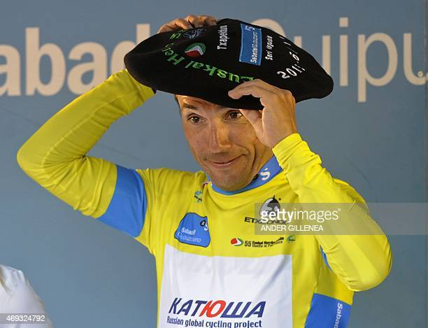 Katusha's Spanish rider Joaquim Rodriguez adjusts a Basque beret as he celebrates his victory on the podium of the last stage of the Tour of the...