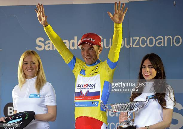 Katusha's Spanish rider Joaquim Rodriguez celebrates his victory on the podium of the last stage of the Tour of the Basque Country in Aia northern...