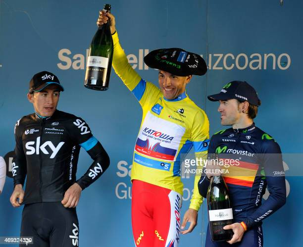 Katusha's Spanish rider Joaquim Rodriguez celebrates his victory with Sky's Colombian rider Sergio Henao and Movistar's Spanish rider Ion Izagirre on...