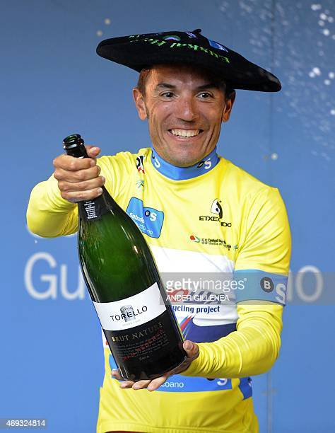 Katusha's Spanish rider Joaquim Rodriguez celebrates his victory with Cava on the podium of the last stage of the Tour of the Basque Country in Aia...
