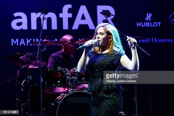 Katy B performs on stage during the amfAR Milano 2013 Gala Auction as part of Milan Fashion Week Womenswear Spring/Summer 2014 at La Permanente on...