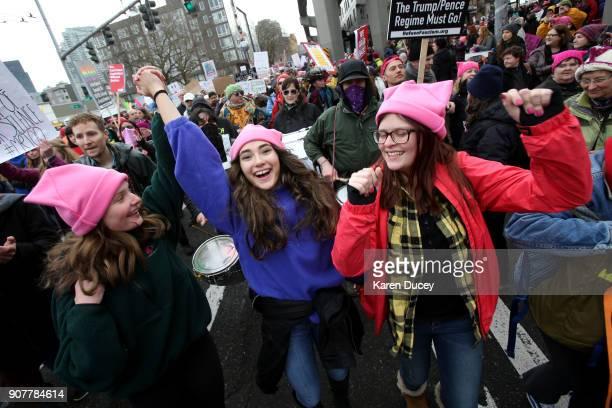 Katy Bordonaro Dima Minkin and Alyssa Bordonaro from Woodinville WA march with thousands in the Women's March on January 20 2018 in Seattle...