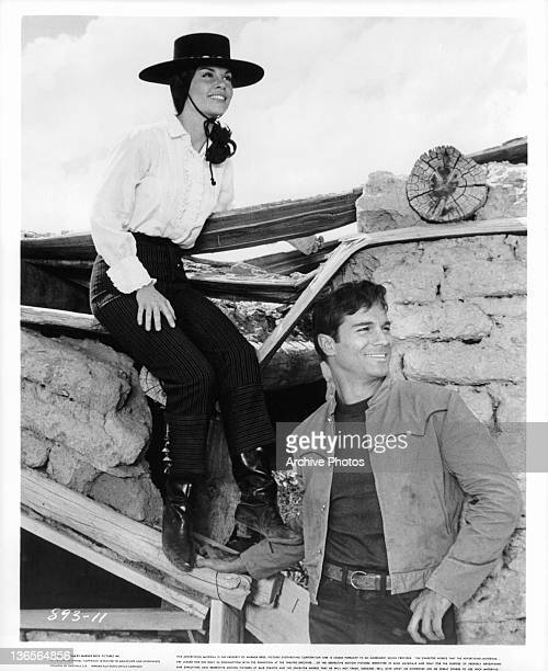 Katy Jurado and George Maharis smiling in a scene from the film 'A Covenant With Death' 1967