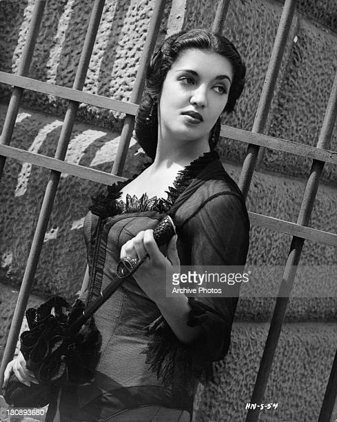 Katy Jurado holding umbrella in a scene from the film 'High Noon' 1952