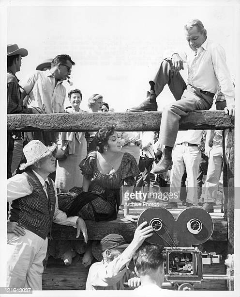 Katy Jurado in offcamera shot with unidentified men from the film 'The Badlanders' 1958