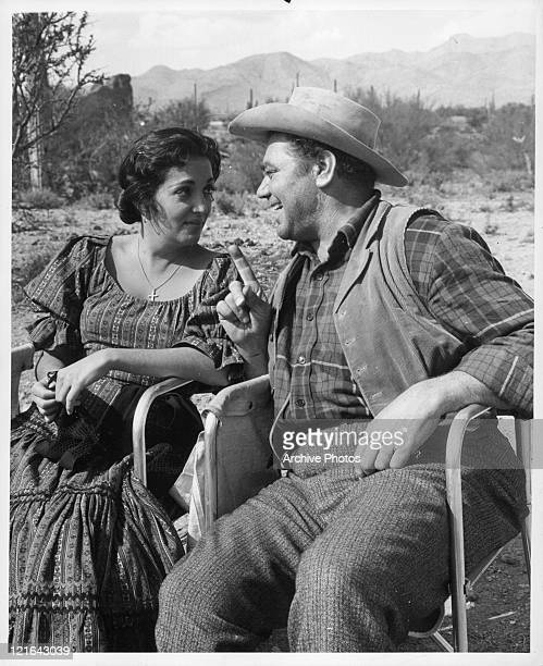 Katy Jurado looking at Ernest Borgnine in a scene from the film 'The Badlanders' 1958