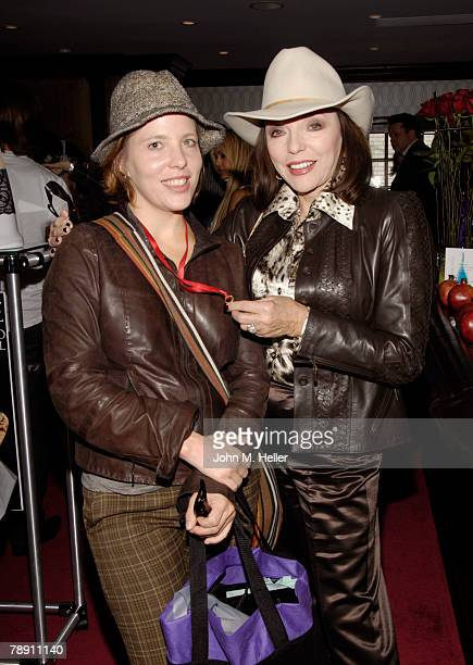 Katy Kass and Joan Collins attends the Secret Room Celebrity Gifting Suite Day 2 for the 66th Annual Golden Globe Awards at Metro Couture on January...