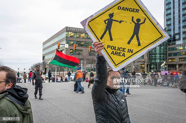 Katy Kostenko a 19year old resident of Cleveland holds a sign in protest on December 29 2015 in Cleveland Ohio Protestors took to the street the day...
