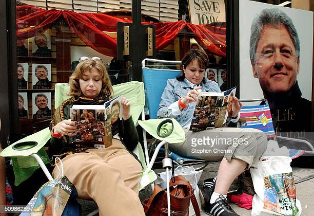 """Katy Krider of Tarrytown, New York, and Natalia Cinkenitsh of Little Neck, New York, read former U.S. President Bill Clinton's book """"My Life"""" as they..."""
