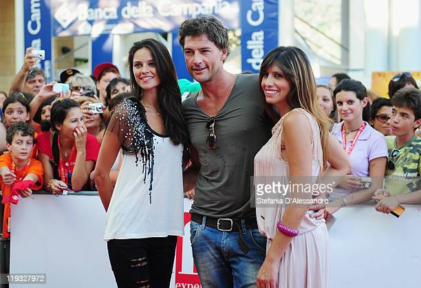 Katy Louise Saunders Roberto Farnesi and Emanuela Tittocchia attend the 2011 Giffoni Experience on July 18 2011 in Giffoni Valle Piana Italy