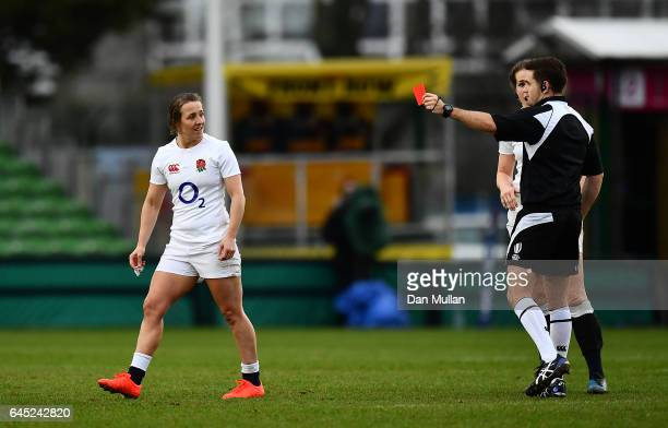 Katy Mclean of England is shown a red card for a dangerous tackle by Referee Graham Cooper during the RBS Womens Six Nations match between England...