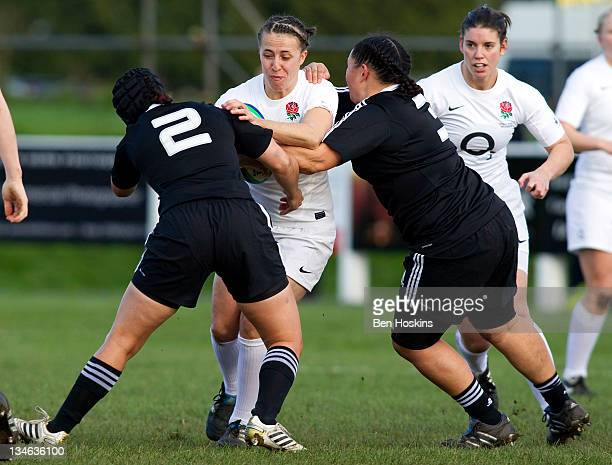 Katy McLean of England is tackled by Karina Penetito and Stephanie TeOhaereFox of New Zealand during the Autumn Internationals Series match between...