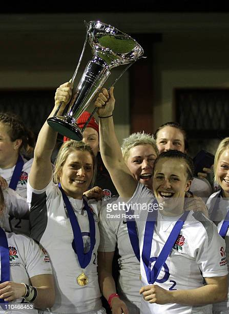 Katy McLean the England captain holds the Six Nations trophy with team mate and former captain Catherine Spencer after their Grand Slam win the...