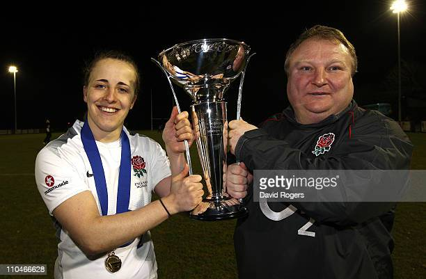 Katy McLean the England captain holds the Six Nations trophy with team coach Gary Street after their Grand Slam win the victory in the Womens Six...