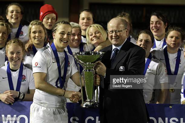 Katy McLean the England captain is presented with the Six Nations trophy after their Grand Slam win the victory in the Womens Six Nations match...