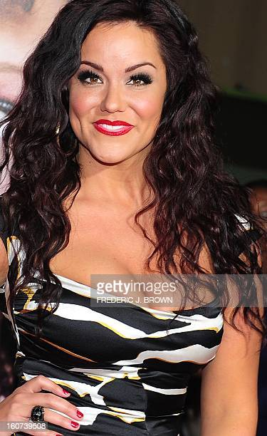 Katy Mixon poses on arrival for the World Premiere of the film 'Identity Thief' in Los Angeles, California, on February 4, 2013. The films opens...