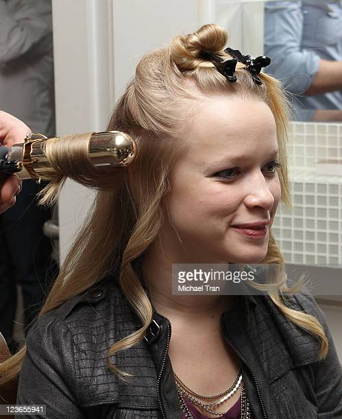 """Katy O' Connell gets her hair worked on at the JM Blowdry booth at KIIS FM's 7th Annual """"Pick Your Purse Party"""" held at Il Cielo on November 17, 2010..."""