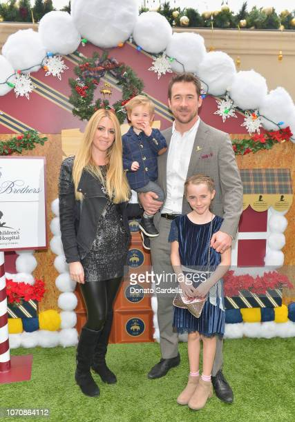 Katy O'Grady and Barry Sloane with family attend the Brooks Brothers and St Jude Children's Research Hospital Annual Holiday Celebration at the...