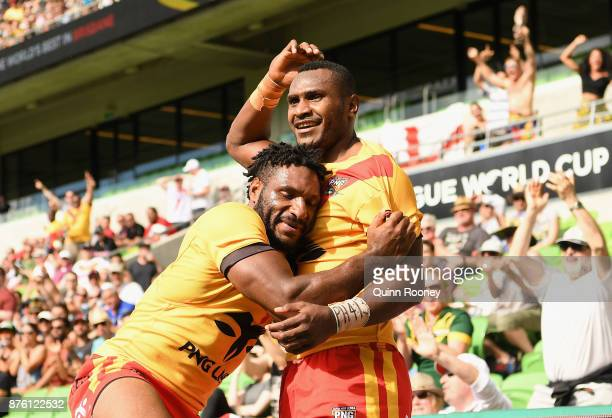 Katy Ottio of Papua New Guinea is congratulated by team mates as they wait for a referee decison on a try during the 2017 Rugby League World Cup...