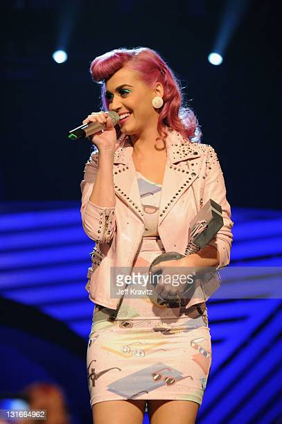 Katy Perry accepts an award onstage during the MTV Europe Music Awards 2011 live show at the Odyssey Arena on November 6 2011 in Belfast Northern...