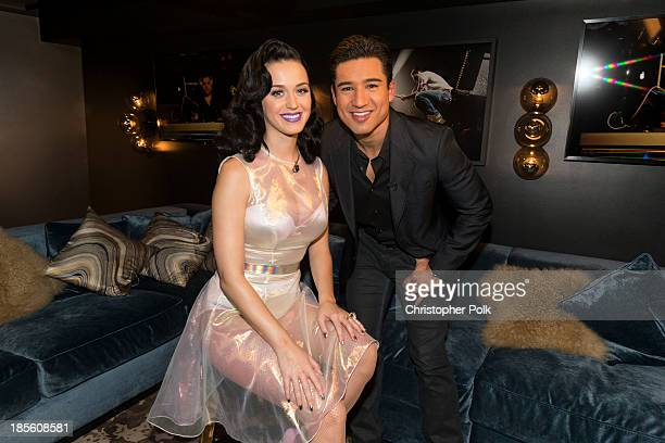 Katy Perry and Actor Mario Lopez attend the Katy Perry iHeartRadio album release party on October 22 2013 in Los Angeles California