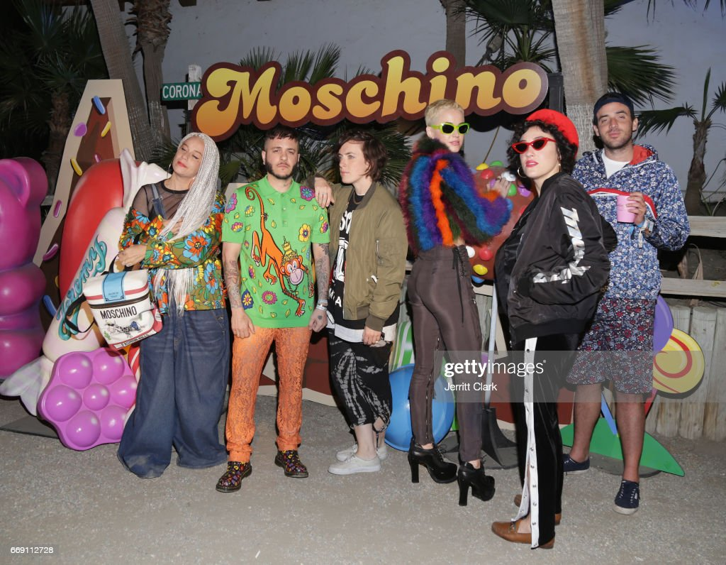Katy Perry (3rd From R) and friends attend the Moschino Candy Crush Desert Party hosted by Jeremy Scott on April 15, 2017 in Coachella, California.