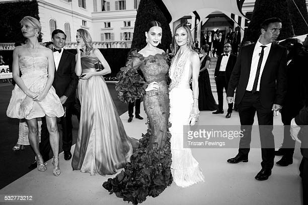 Image has been converted to black and white Katy Perry and Georgina Chapman attend the amfAR's 23rd Cinema Against AIDS Gala at Hotel du CapEdenRoc...