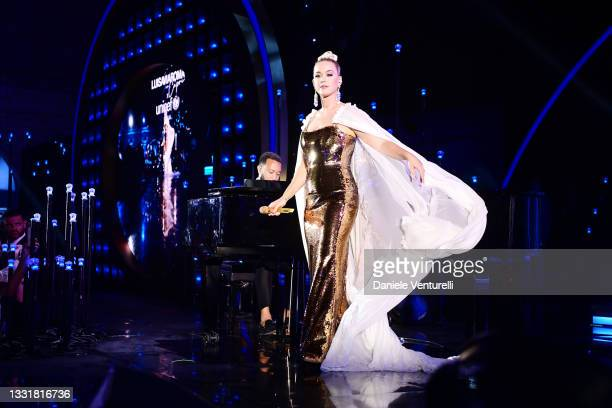Katy Perry and John Legend perform during the LuisaViaRoma for Unicef event at La Certosa di San Giacomo on July 31, 2021 in Capri, Italy.