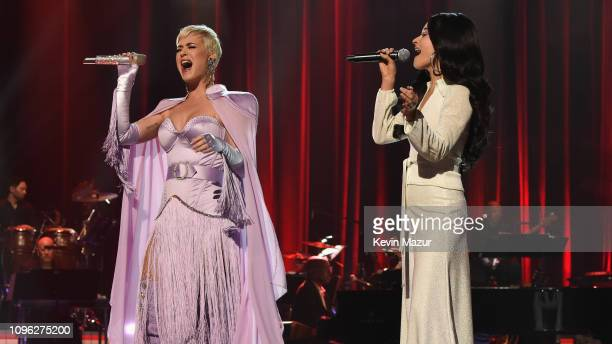 Katy Perry and Kacey Musgraves perform onstage during MusiCares Person of the Year honoring Dolly Parton at Los Angeles Convention Center on February...