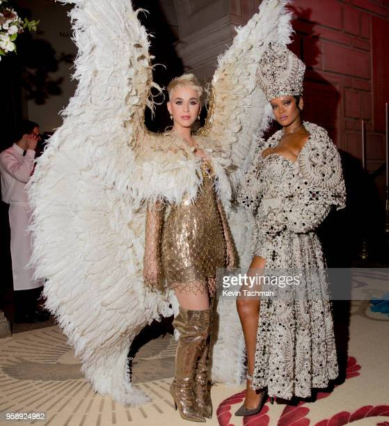 Katy Perry and Rihanna attend the Heavenly Bodies Fashion The Catholic Imagination Costume Institute Gala at The Metropolitan Museum of Art on May 7...