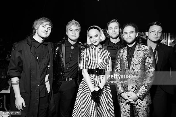 Katy Perry and Zedd pose with 5 Seconds of Summer during the 2019 iHeartRadio Music Awards which broadcasted live on FOX at Microsoft Theater on...