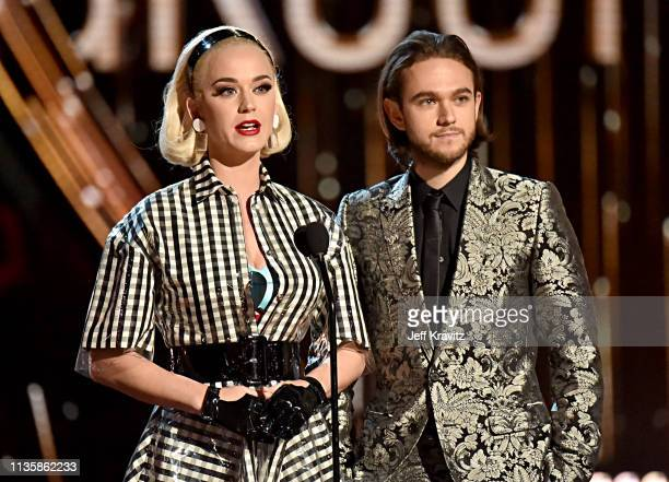 Katy Perry and Zedd speak on stage at the 2019 iHeartRadio Music Awards which broadcasted live on FOX at the Microsoft Theater on March 14, 2019 in...