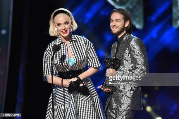 Katy Perry and Zedd speak on stage at the 2019 iHeartRadio Music Awards which broadcasted live on FOX at Microsoft Theater on March 14 2019 in Los...