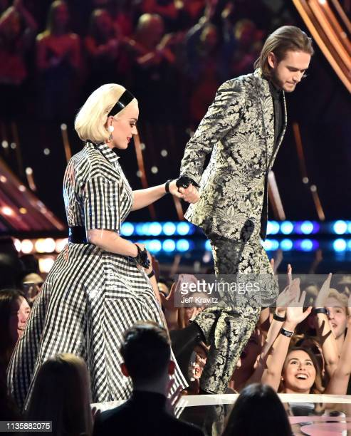 Katy Perry and Zedd walk on stage at the 2019 iHeartRadio Music Awards which broadcasted live on FOX at the Microsoft Theater on March 14 2019 in Los...