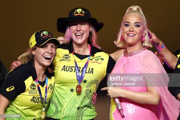 Katy Perry dances with Ellyse Perry of Australia and team mates on stage during a concert after their victory in the ICC Women's T20 Cricket World...