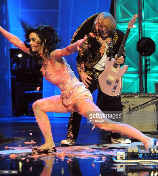 Katy Perry falls after jumping on a cake during her performance at the 7th Annual 'Los Premios MTV Latin America 2008' Awards held at the Auditorio...