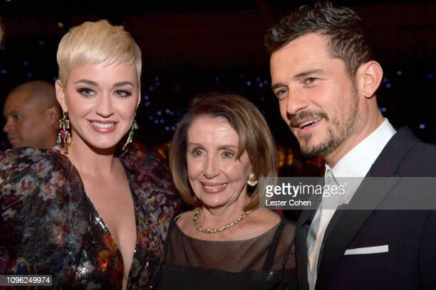 Katy Perry Nancy Pelosi and Orlando Bloom attend MusiCares Person of the Year honoring Dolly Parton at Los Angeles Convention Center on February 8...