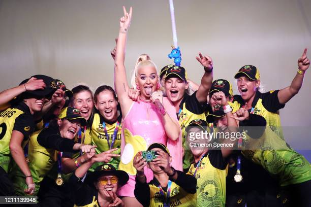 Katy Perry performs on stage with the Australian cricket team following their victory in the ICC Women's T20 Cricket World Cup Final match between...
