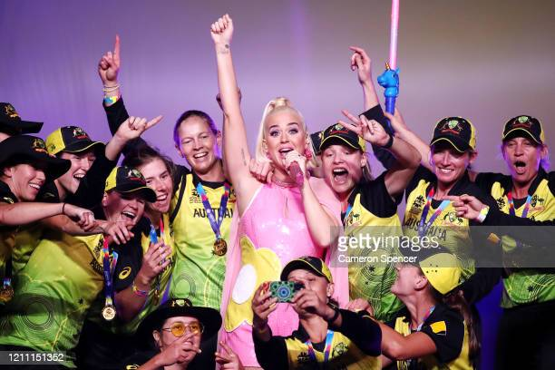 Katy Perry performs on stage with the Australian team during a concert after their victory in the ICC Women's T20 Cricket World Cup Final match...
