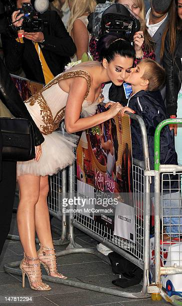 Katy Perry receives a kiss from Con GibbsMcNeil at the European premiere of Katy Perry Part Of Me 3D at Empire Leicester Square on July 3 2012 in...
