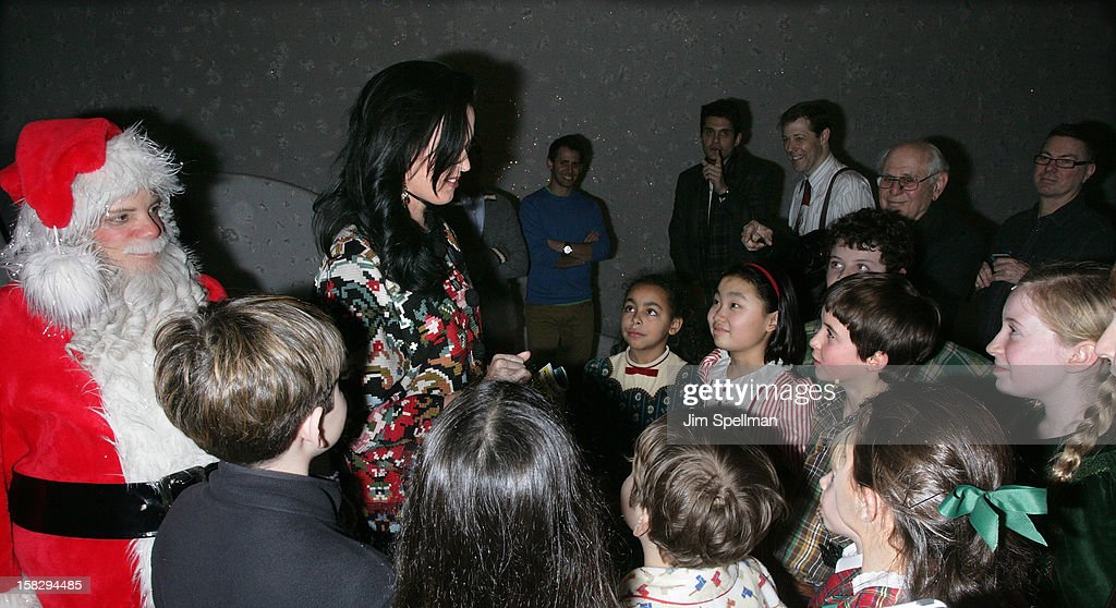 Katy Perry with the young cast of 'A Christmas Story, The Musical' Broadway Performance at Lunt-Fontanne Theatre on December 12, 2012 in New York City.