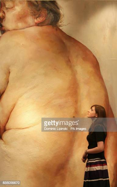 Katy Richards a member of staff at Christie's auction house Kensington is seen with 'Juncture' by Jenny Saville which is expected to fetch 300000 to...