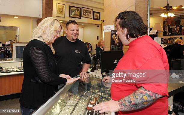 Katy Rygaard and Ax Men Gabe Rygaard purchase a ring from Pawn Stars Austin Chumlee Russell at Gold and Silver Pawn on April 7 2010 in Las Vegas...