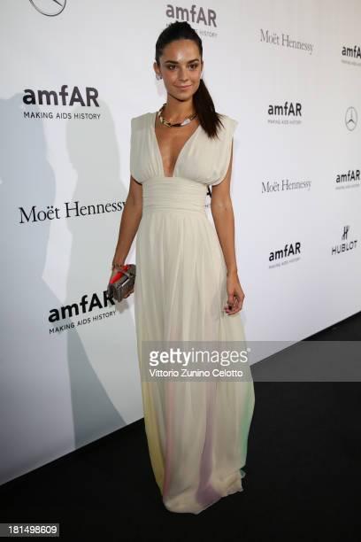 Katy Saunders attends the amfAR Milano 2013 Gala as part of Milan Fashion Week Womenswear Spring/Summer 2014 at La Permanente on September 21, 2013...