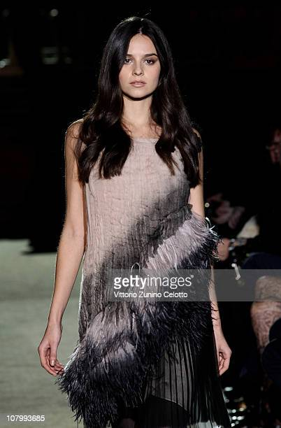 Katy Saunders walks the runway during the Alberta Ferretti fashion show during Pitti Immagine Uomo 79 on January 11 2011 in Florence Italy